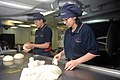 U.S. Navy Culinary Specialist Seaman Jason Bennett, from Cuyahoga Fall, left, and Culinary Specialist Seaman Jaqueline Friend make dinner rolls aboard the aircraft carrier USS George H.W. Bush (CVN 77) in 130521-N-CZ979-055.jpg