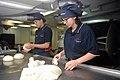 U.S. Navy Culinary Specialist Seaman Jason Bennett, from Cuyahoga Fall, left, and Culinary Specialist Seaman Jaqueline Friend make dinner rolls aboard the aircraft carrier USS George H.W. Bush (CVN 77) in 130521-N-CZ979-055.jpg