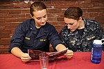 "U.S. Navy Midshipman 3rd Class Suzy Waters, left, and Midshipman 3rd Class Katherine Baile, both from Penn State University, read ""The Nimitz News"" in Wardroom III aboard the aircraft carrier USS Nimitz (CVN 68) 130623-N-IB033-168.jpg"
