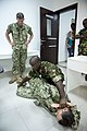 U.S. Navy Petty Officer 2nd Class John A. Wilcox, left, a Navy maritime interdiction operations team member, observes as a fellow Sailor demonstrates mechanized advantage control hold techniques for Seychellois 131106-N-EZ054-236.jpg