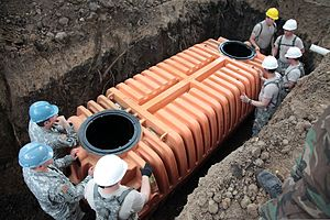 U.S. Soldiers with the 829th Engineer Company, Wisconsin Army National Guard install a septic tank in support of Beyond the Horizon (BTH) 2013 in Sonsonate, El Salvador, May 29, 2013 130529-A-MR246-451.jpg