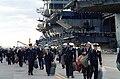 USS America (CV-66) crew depart at Norfolk.jpg