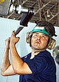 US Navy 030614-N-9662L-005 Aviation Machinist Mate 3rd Class Ines J. Ramos from Quitman, Texas, torques a propeller nut.jpg