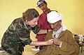 US Navy 030909-N-4329R-001 Cmdr. Deborah Williams listens to the heart of an elderly Moroccan man.jpg
