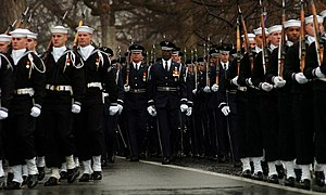 Military funerals in the United States - Escort platoons marching during the military funeral of Admiral Thomas Hinman Moorer in Arlington National Cemetery, 2004.