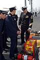 US Navy 040226-N-9860Y-016 Damage Control Chief George Marquez, of San Francisco, Calif., describes the features of a firefighting box-fan.jpg