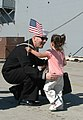 US Navy 040309-N-7615S-129 A Sailor gets an enthusiastic greeting after returning from a six and half month deployment with Expeditionary Strike Force One (ESG-1).jpg