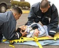 US Navy 040323-N-0000W-013 Hospital Corpsman Fernando Prieto and Hospital Corpsman Raulito Galgana demonstrate life saving techniques in the parking lot outside the Emergency Room of U.S. Naval Hospital Yokosuka, Japan.jpg