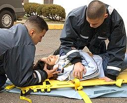 US Navy 040323-N-0000W-013 Hospital Corpsman Fernando Prieto and Hospital Corpsman Raulito Galgana demonstrate life saving techniques in the parking lot outside the Emergency Room of U.S. Naval Hospital Yokosuka, Japan