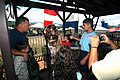 US Navy 040502-N-8157C-004 Operation's Specialist 2nd Class John Hall, left, a Navy diver assigned to Mobile Diving Salvage Unit One (MDSU-1), shows children a deep sea diving helmet.jpg