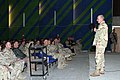 US Navy 050113-M-4711R-019 Chief of Naval Operations (CNO), Adm. Vern Clark, addresses Navy and Marine personnel at the base theater at Al Asad, Iraq.jpg