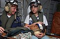 US Navy 050206-N-6665R-101 Cmdr. Karen McDonald, left, and a nurse from the non-governmental organization Project Hope, comfort a young boy suffering from a perforated appendix as they are flown to Mercy in a U.S. military heli.jpg