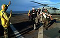 US Navy 050407-N-6504N-011 Retired Rear Adm. William McDaniel, left, leads Chief Hospital Corpsman Patrick Nardulli as he carries an Indonesian child from an MH-60S Seahawk helicopter.jpg