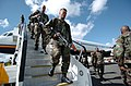 US Navy 050613-N-0696M-083 Members of the 1-501 Parachute Field Artillery Regiment, stationed in Fort Richardson, Alaska, unload after arriving at Rockhampton Airport for the combined exercise Talisman Sabre 2005.jpg