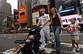 US Navy 060526-N-4936C-007 Fire Controlman 2nd Class Josh Laven strolls through Times Square with his family in New York City during Fleet Week New York.jpg