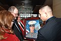 US Navy 070112-M-1529O-007 Deb and Dan Dunham, the parents of Cpl. Jason L. Dunham, receive a hand painted image of their son from Cpl. Jason R. Hopwood, a Marine Corps graphic artist, at the Marine Corps Museum.jpg