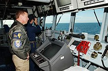 US Navy 070515-N-5459S-004 Commander, Standing NATO Maritime Group One (SNMG1), Rear Adm. Michael K. Mahon observes the horizon of the Baltic Sea from the bridge of guided missile destroyer USS Mahan (DDG 72).jpg