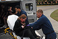 US Navy 070920-N-8907D-108 Sailors load roll players into an ambulance during a mock chemical, biological, and radiological (CBR) attack on Naval Medical Center Portsmouth, during Exercise Solid Curtain.jpg