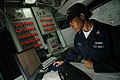 US Navy 071118-N-0167B-178 Sonar Technician (Surface) 2nd Class Marquerite Gerald, of Arlington, Texas, looks through maintenance logs as she stands combat systems officer of the watch aboard the guided-missile cruiser USS Shil.jpg