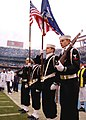 US Navy 080106-N-0515W-112 The color guard team from the amphibious dock landing ship USS Rushmore (LSD 47) presents colors at Qualcomm Stadium in San Diego, Calif.jpg