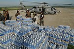 US Navy 080626-N-4009P-635 Bottles of water transported from the Nimitz-class aircraft carrier USS Ronald Reagan (CVN 76) wait to be delivered to devastated areas in the Republic of the Philippines.jpg
