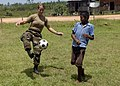US Navy 080818-N-3595W-198 Information Systems Technician 2nd Class Danielle Church, assigned aboard the amphibious assault ship USS Kearsarge (LHD 3), plays soccer with a Nicaraguan child at the medical site in Betania during.jpg