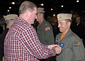 US Navy 080926-N-9860Y-003 Nate Patterson presents Chief Hospital Corpsman Greg Highfill with an Air Medal.jpg