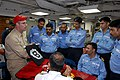 US Navy 081018-N-1635S-010 Chief Damage Controlman Tom Kennedy demonstrates U.S. damage control techniques to sailors of the Indian Navy aboard the guided-frigate USS Thach (FFG 43).jpg
