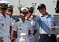 US Navy 081118-N-6764G-089 Boatswain's Mate 2nd Class Charles Stillinger explains foc'sle operations to Republic of Korea Midshipmen.jpg