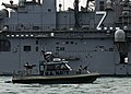 US Navy 090214-N-9671T-288 A port security boat approachesUSS Iwo Jima (LHD 7) while providing port security.jpg