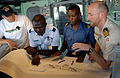 US Navy 090227-N-1688B-025 Royal Danish Navy Lt. Cmdr. Daniel Christensen, right, gives navigation training to Ghanaian Naval and Air Force officers aboard the amphibious transport dock ship USS Nashville (LPD 13).jpg