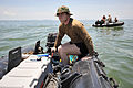 US Navy 090327-N-2383D-037 Sonar Technician (Surface) 2nd Class Dan Simmering steers his Zodiac boat toward the middle of the debris field of the crashed Ilyushin 76 aircraft.jpg