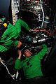 US Navy 090518-N-3946H-044 Aviation Machinist's Mate 2nd Class Norland Obillo and Aviation Machinist's Mate 3rd Class David Carbajal install a fuel line in the engine of an F-A-18F Super Hornet.jpg