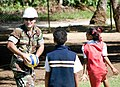 US Navy 090717-N-9689V-010 Lt.j.g. Shawn Talley, assigned to Amphibious Construction Battalion (ACB) 1, plays ball with local schoolchildren during a Pacific Partnership 2009 engineering civic action project.jpg