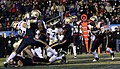 US Navy 091212-N-3066M-004 Navy wide receiver Greg Jones intercepts a pass in the end zone in the fourth quarter during the 110th Army-Navy college football game at Lincoln Financial Field in Philadelphia.jpg