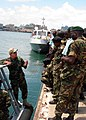 US Navy 100121-N-XXXXH-098 Constructionman 1st Class Robert Taylor, an Africa Partnership Station (APS) East instructor, teaches a small boat maintenance course to Tanzanian maritime students in Dar Es Salaam, Tanzania.jpg