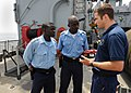 US Navy 100419-N-6676S-046 U.S. Coast Guard Maritime Enforcement Specialist 2nd Class Daniel Chase gives Gambia sailors instructions before beginning a Basic Boarding Officer Course practical exercise.jpg