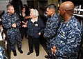 US Navy 100715-N-5658B-014 Command Chaplain Cmdr. Cameron Fish and former First Lady Barbara Bush tour the ship's library aboard the aircraft carrier George H.W. Bush (CVN 77).jpg