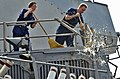 US Navy 110215-N-XO436-111 Fire Controlman 1st Class Anita Abbadini, left, and Fire Controlman 3rd Class Steven Limpert, sweep water off the deck d.jpg