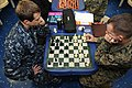 US Navy 110226-N-UE944-013 Intelligence Specialist 2nd Class Richard Evitts, left, and Pfc. Rick Griesbach play chess on the mess decks of the amph.jpg