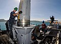 US Navy 111123-N-UE250-062 Gunner's Mate 2nd Class Damien Elser, assigned to the submarine tender USS Frank Cable (AS 40), guides a Capsule Launch.jpg