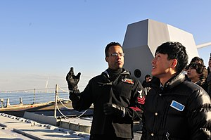 US Navy 120203-N-ER662-324 Gas Turbine System Technician (Mechanical) 1st Class Charles Chennault gives a tour of the Arleigh Burke-class guided-mi.jpg
