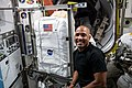 Victor Glover works on US spacesuit maintenance inside the Quest airlock 01.jpg