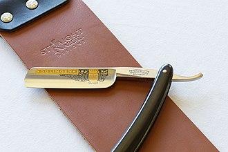 Razor - A straight razor on a leather strop