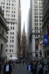 Looking west toward Trinity Church  a crowd on Wall Street is pictured in  the foreground 3733e030e60a3