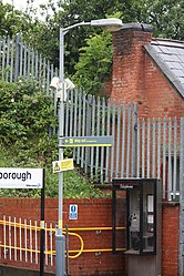 Way out sign at Bromborough railway station (28036468213).jpg