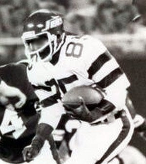 Logos and uniforms of the New York Jets - Wide receiver Wesley Walker wearing the 1978-89 uniform. Note the green helmet and modified shoulder/sleeve design.