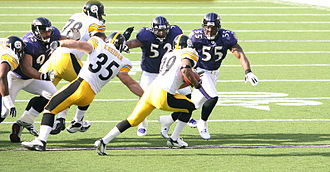 Terrell Suggs - From left to right: Haloti Ngata, Lewis, and Suggs chasing down Willie Parker of the Steelers in 2006.