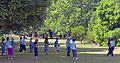 Women doing tai chi in a vista at Kew Gardens.jpg