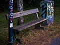 Wooden bench chained to a light pole.jpg